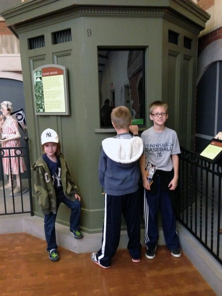 Hunter buying tickets from an original ticket booth from the original Yankee Stadium